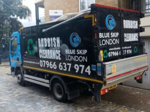 Blue Skip London Lorry at work