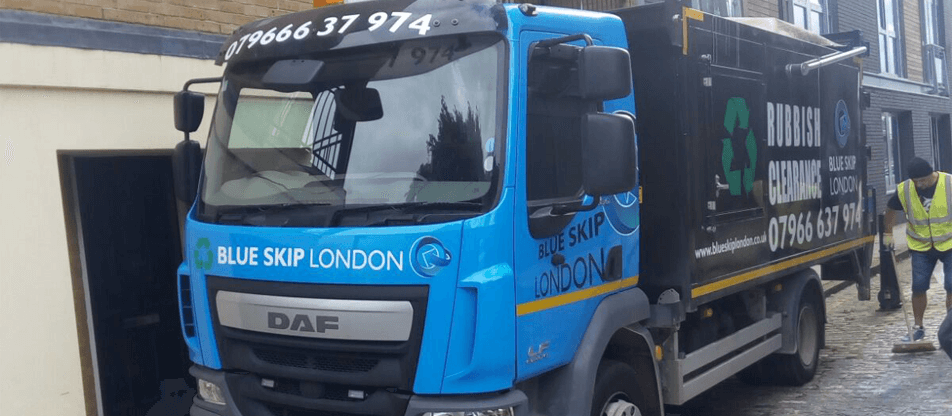Blue Skip London man at work