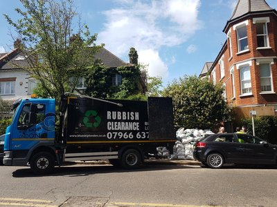 Blue Skip van in Ealing